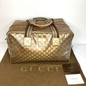 Authentic Gucci gold canvas travel/duffle bag